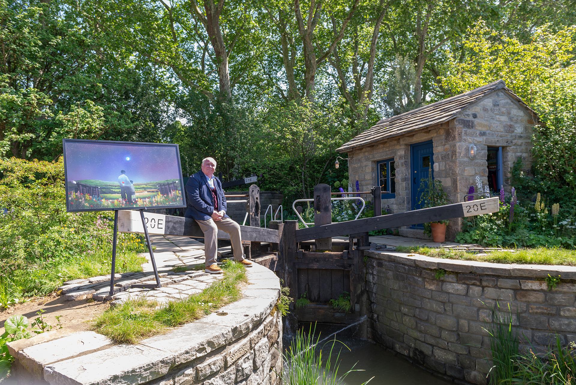Artist mackenzie thorpe unveils welcome to yorkshire artwork alongside Chelsea flower show garden 2019